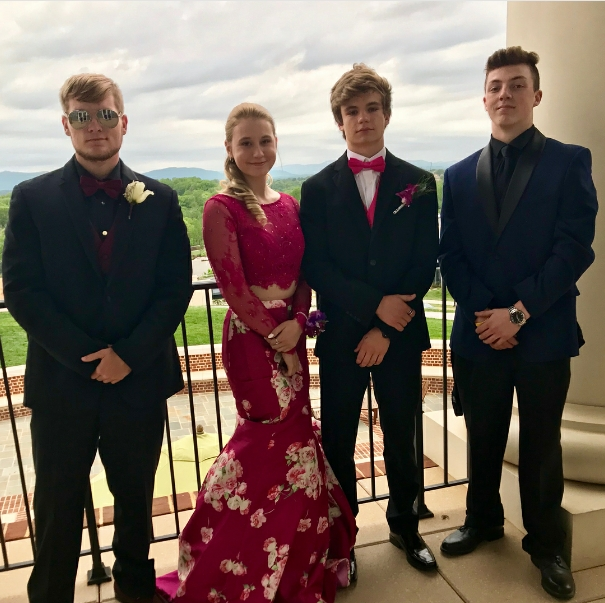 Posing+in+her+prom+dress%2C+junior+Bailey+Livingston+is+accompanied+by+senior+Ethan+Valentine%2C++sophomore+Daniel+Garrett%2C+and+her+prom+date%2C+sophomore+Noah+Fulmer.