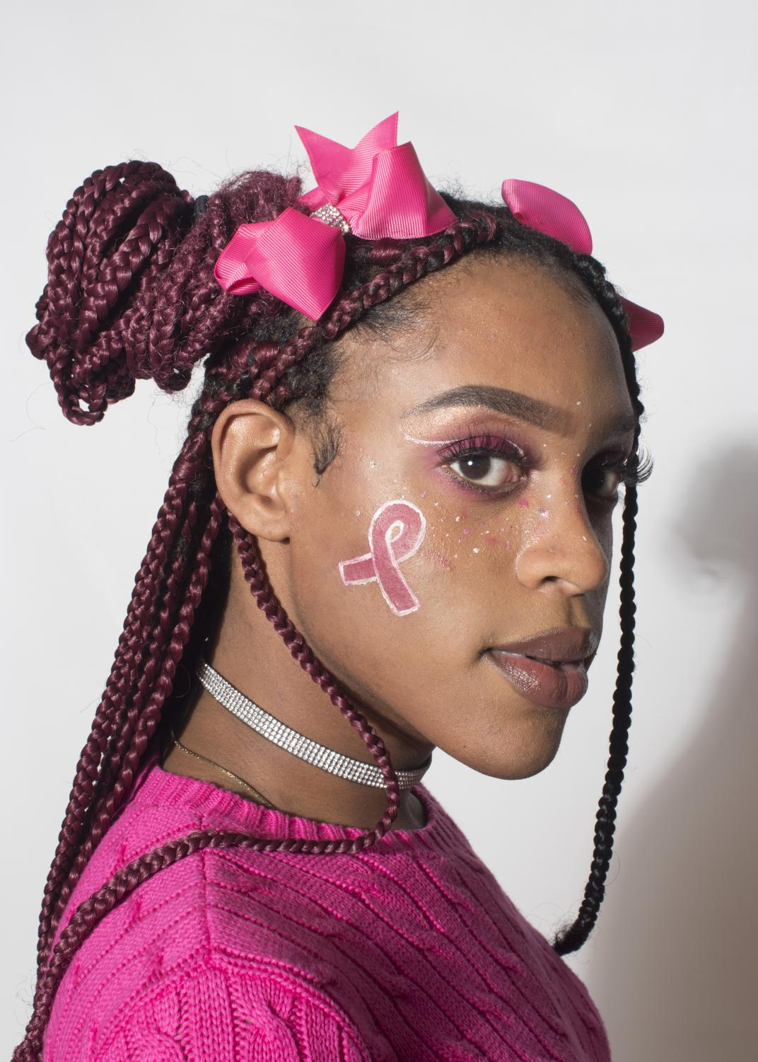 Junior Mi'Kel Jenkin's perfectly pink makeup during Spirit Week helps represent the Breast Cancer Awareness Movement.